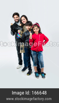 Indian family eating ice cream in warm clothes on white background