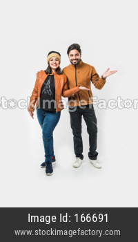 Indian young couple in winter wear /warm clothes against white background