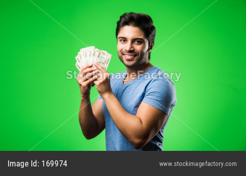 Indian happy man with money fan, standing isolated against green chroma screen