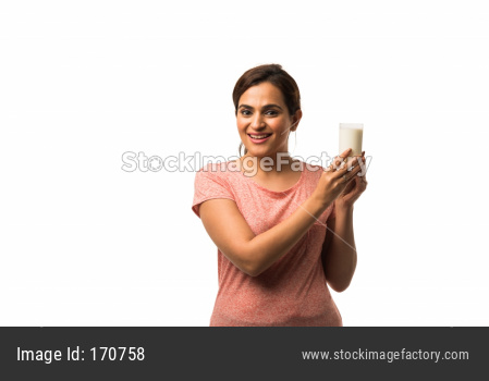 Portrait young Indian/asian woman drinking milk from the glass isolated over white background