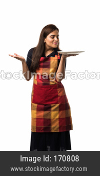 Indian girl holding empty white plate