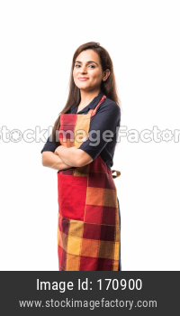woman chef or cook in apron, presenting, pointing, with ok sign, thumbs up or hands folded