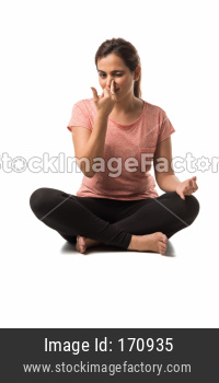 Indian Woman / Girl performing Yoga asana or meditation or dhyan, sitting isolated over white background