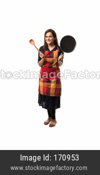 Indian / asian woman chef wearing Apron and holding Pan and spatula while standing isolated over white background