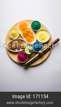 Happy Holi colours with Indian sweet food or dessert