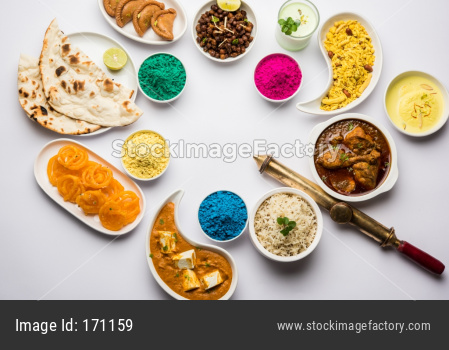 Happy Holi colours with Indian lunch food and sweet food or dessert