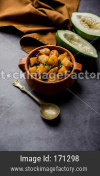 Kacha Papita sabzi with gravy or Raw Papaya curry Sabji , served in a bowl. selective focus