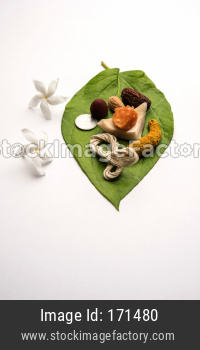 Hindu Puja with betel leaf, supari, janeu, almond, dates, turmeric, dried coconut and jaggery with 1 rupee coin. Important item