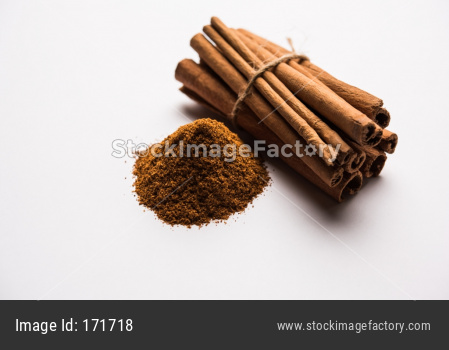 Powder cinnamon and sticks also known as Dalchini or Dalcheenee masala from India, selective focus