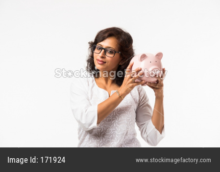 Indian lady/women with piggy bank, standing isolated over white background