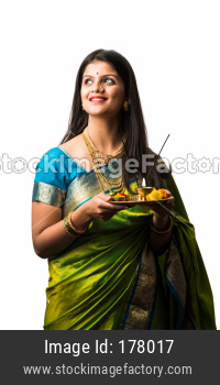 Female model with puja thali