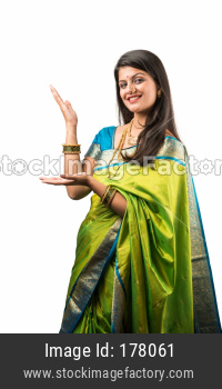 Indian Girl or woman in saree presenting blank space