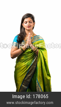 Indian Woman in saree praying with closed eyes