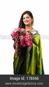 Woman holding flower garland for decoration