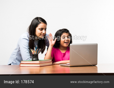 Indian Girl attending Online class and mother helping