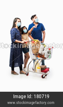 Indian family with shopping cart wearing face mask