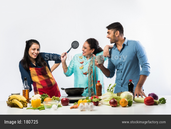 Indian Family In Kitchen