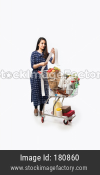 Indian young girl with shopping trolly or cart
