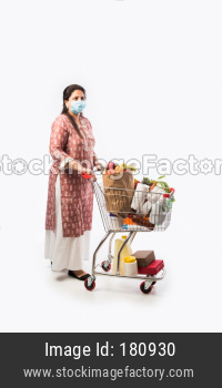 Indian mother and daughter with shopping cart or trolly