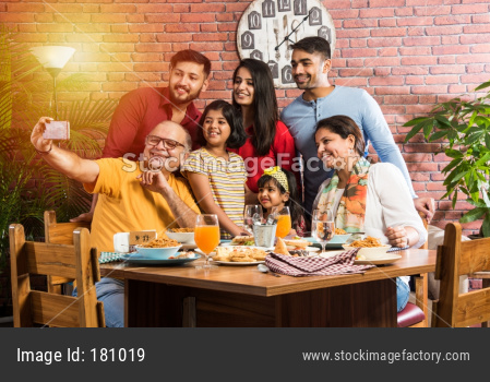 Indian Family eating food in restaurant or home on dining table