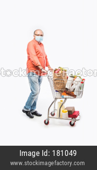 Indian old man with face mask pushing shopping cart or trolly