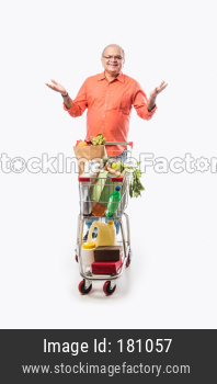 Indian old man with shopping cart or trolly