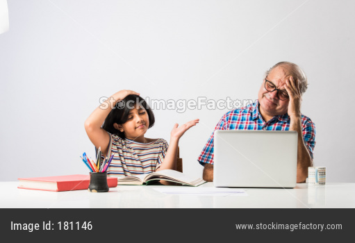 Indian girl studying with grandfather