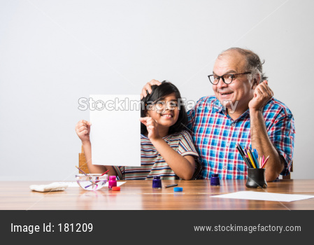 Girl drawing or painting with grandfather