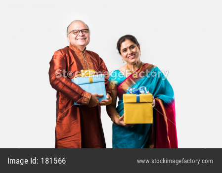 Indian happy couple holding gift boxes