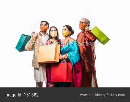 Family wears face mask while shopping