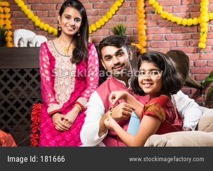 Family celebrating Raksha Bandhan or Rakhi festival