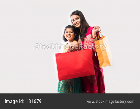 Two indian asian girls or sisters shopping