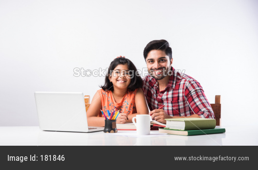 Father daughter studying with laptop and books