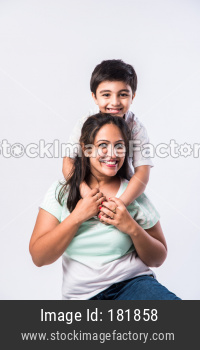 Portrait of Indian young mother and son against white background, looking at camera