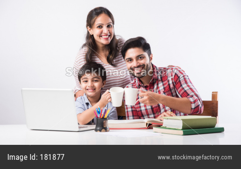 Indian kid studying online, attending school via e-learning with father and mother