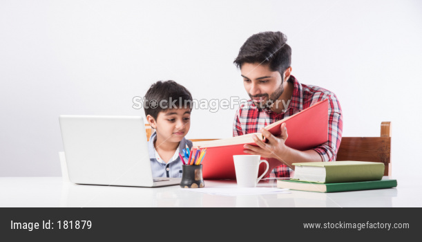 Indian kid studying online, attending school via e-learning with father