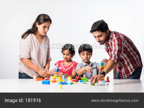 Kids playing with toys or blocks with young parents