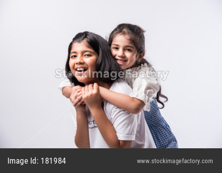 cute little Indian sisters