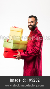 Bearded man in ethnic wear with gift boxes