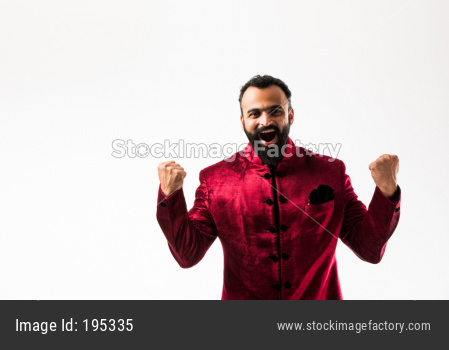 Bearded man in ethnic wear celebrating success or happiness